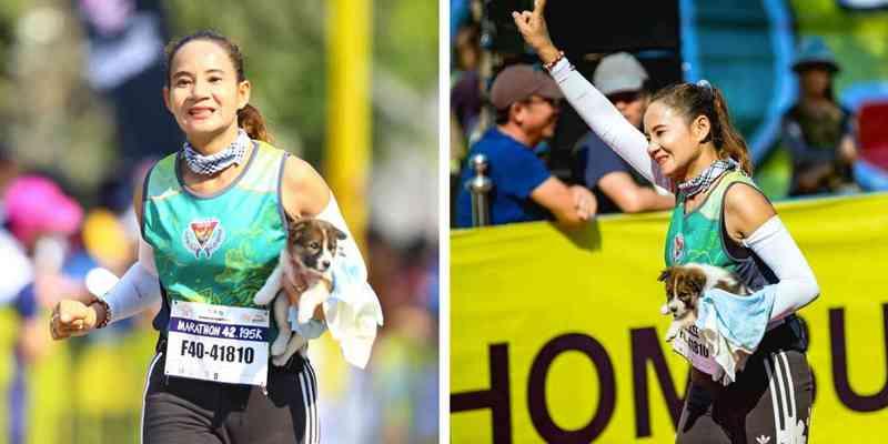 Mulher acaba maratona carregando cachorro que ela havia salvo durante a corrida; vídeo