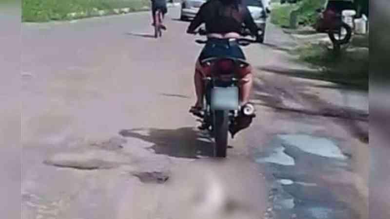 Mulher que arrastou gato em motocicleta é identificada e intimada a depor na Polícia
